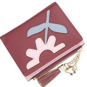 Dompet Warna Maroon dengan resleting aksesoris rumbai