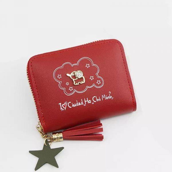 Dompet ukuran kecil cukup untuk kartu dan koin disertai gambar gajah mini gold dan text I love ciudad ho chi minh